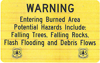 Warning entering burned area. Potential hazards include: falling trees, falling rocks, flash floodin