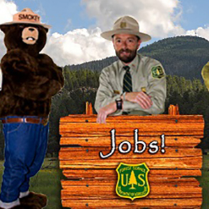Sign with Ranger behind and Smokey to the left, Jobs!  and FS shield  on sign