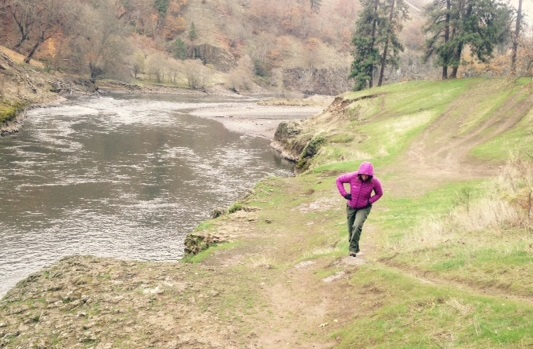 Person walking alongside the Klickitat River.