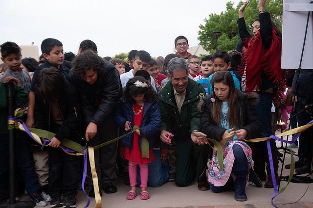 Cal and Kids Cutting Riobbon at Grand Opening