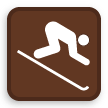 A button icon indicates downhill skiing