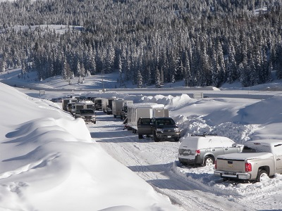 Cars parked along a snow embankment at Vail Pass