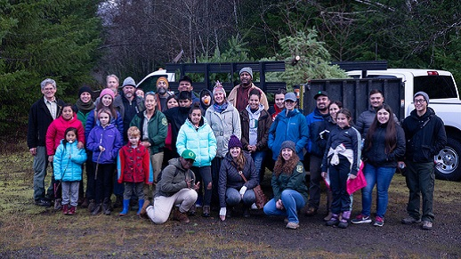 A group poses during a holiday tree outing in November.