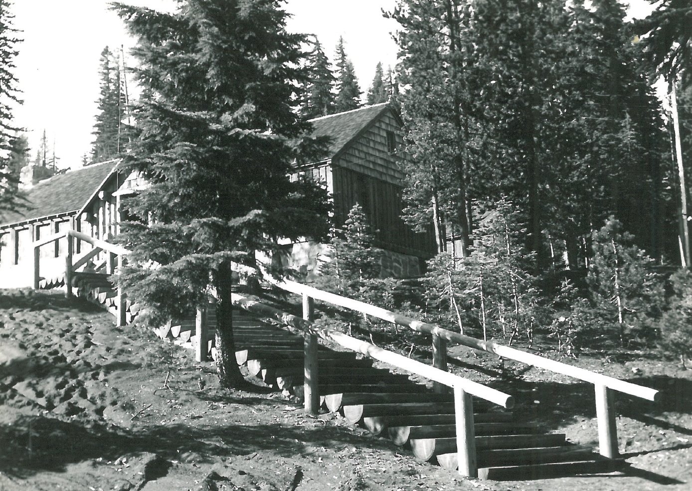 Black and white picture of a small wooden lodge