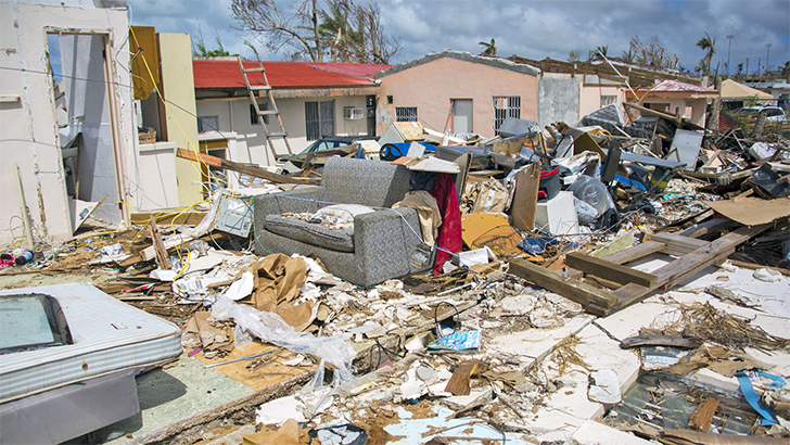 Homes are torn apart by a super typhoon.