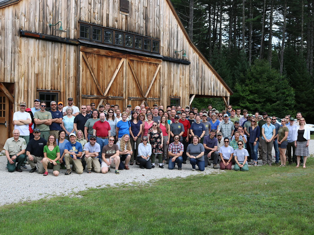 Employees of the White Mountain National Forest gather at the history Russell Corbath barn.