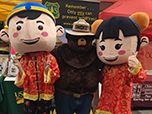 Smokey meets new friends at the Chinese New Year Community Street Fair.
