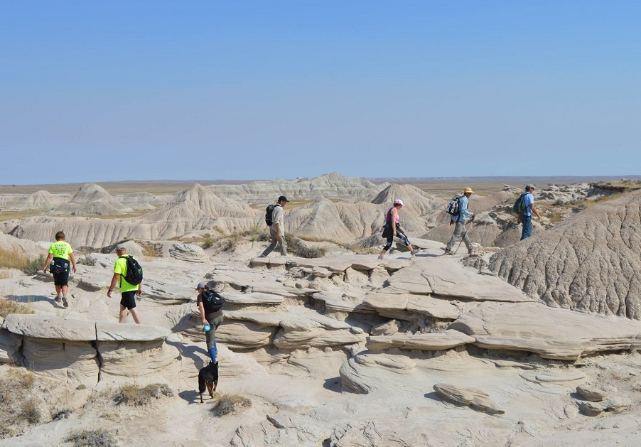 A group of people view unique geological formations