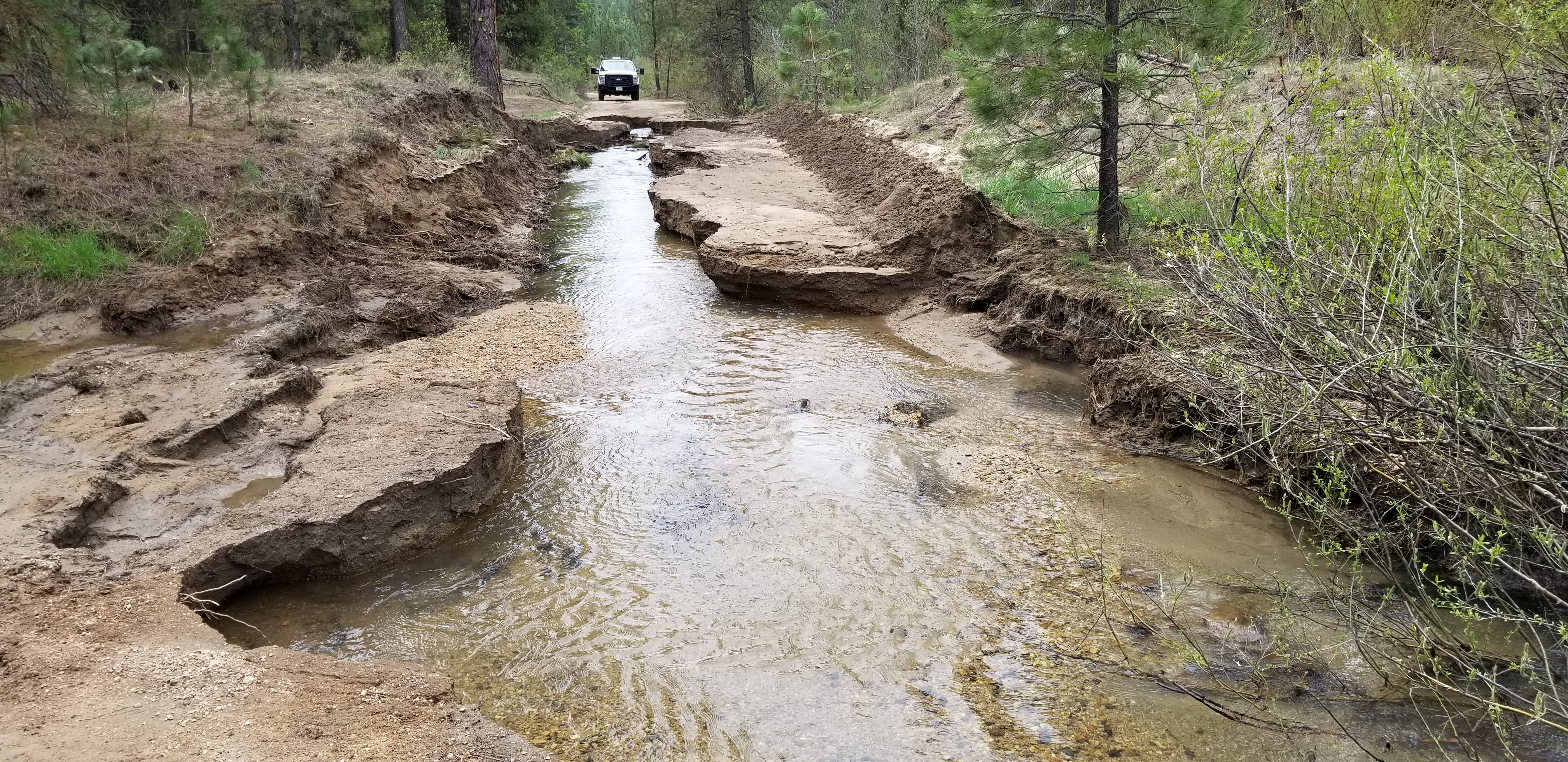 Photo of a road ditched and covered with water