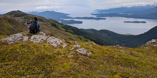Hiker on Alice Smith Intertie trail in Cordova, Alaska. Photo by Melissa Gabrielson.