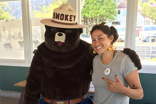 A Forest Service intern hamming it up with Smokey.