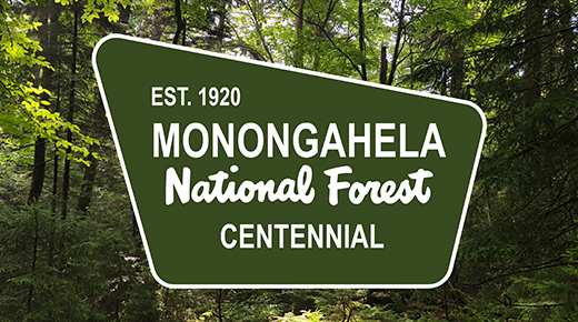Text on a sign says Est. 1920 Monongahela National Forest Centennial.