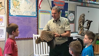 Forest Ranger talks to young students