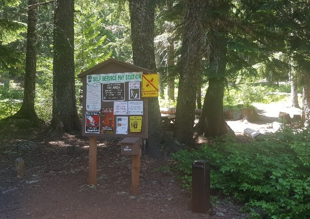 Sign in a wooded campground.