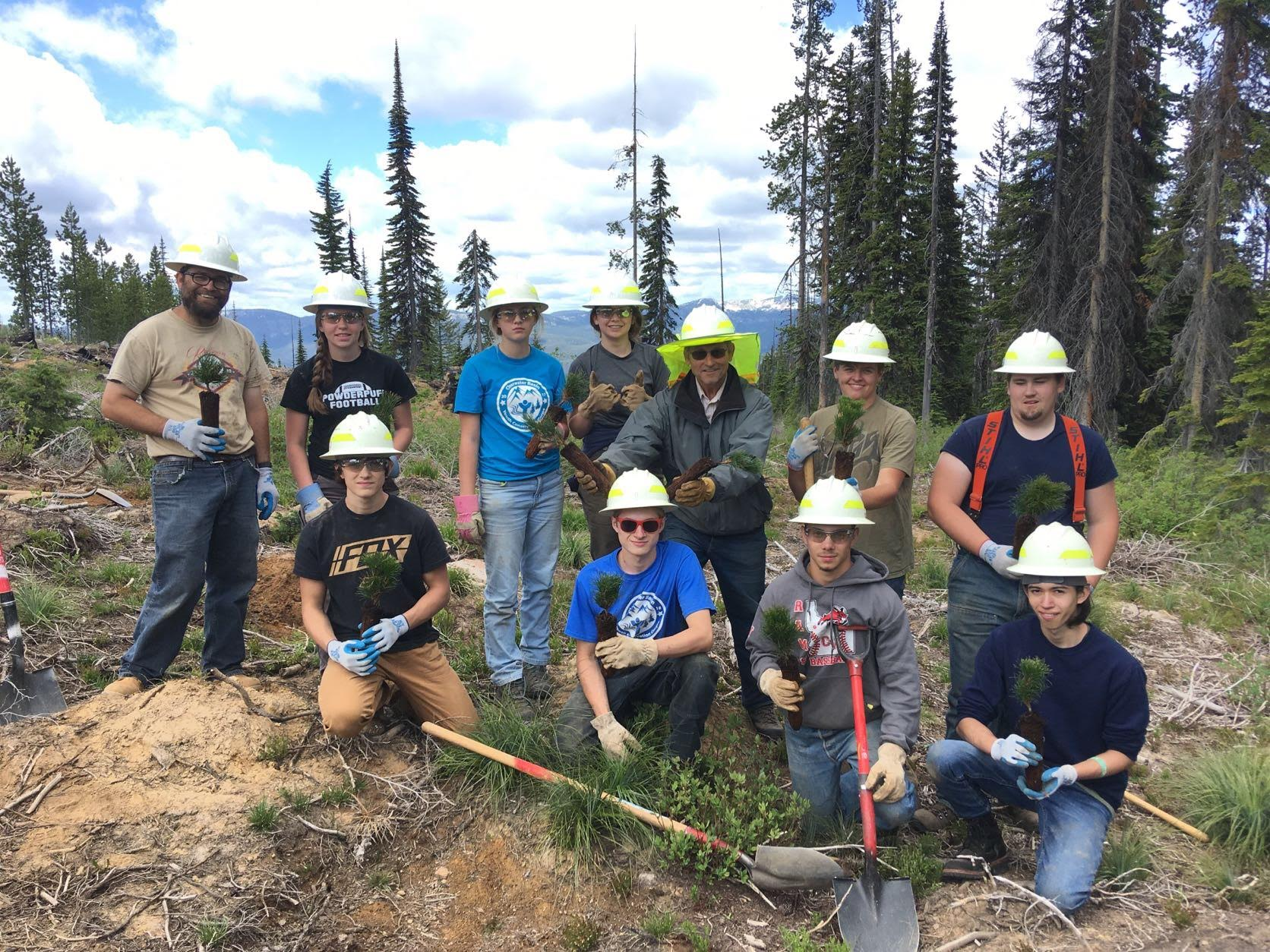 A group of 11 people from the Kooskia CBYCC crews pose in the woods where they had been planting seedlings.