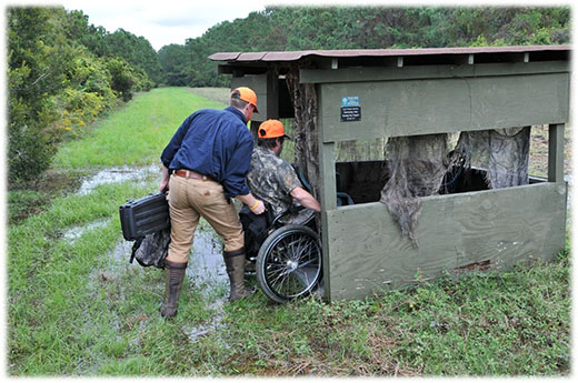 Person being wheeled in a hunting blind