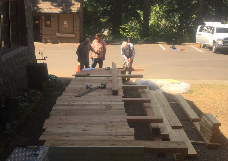 Building a wooden bridge on site before moving it.