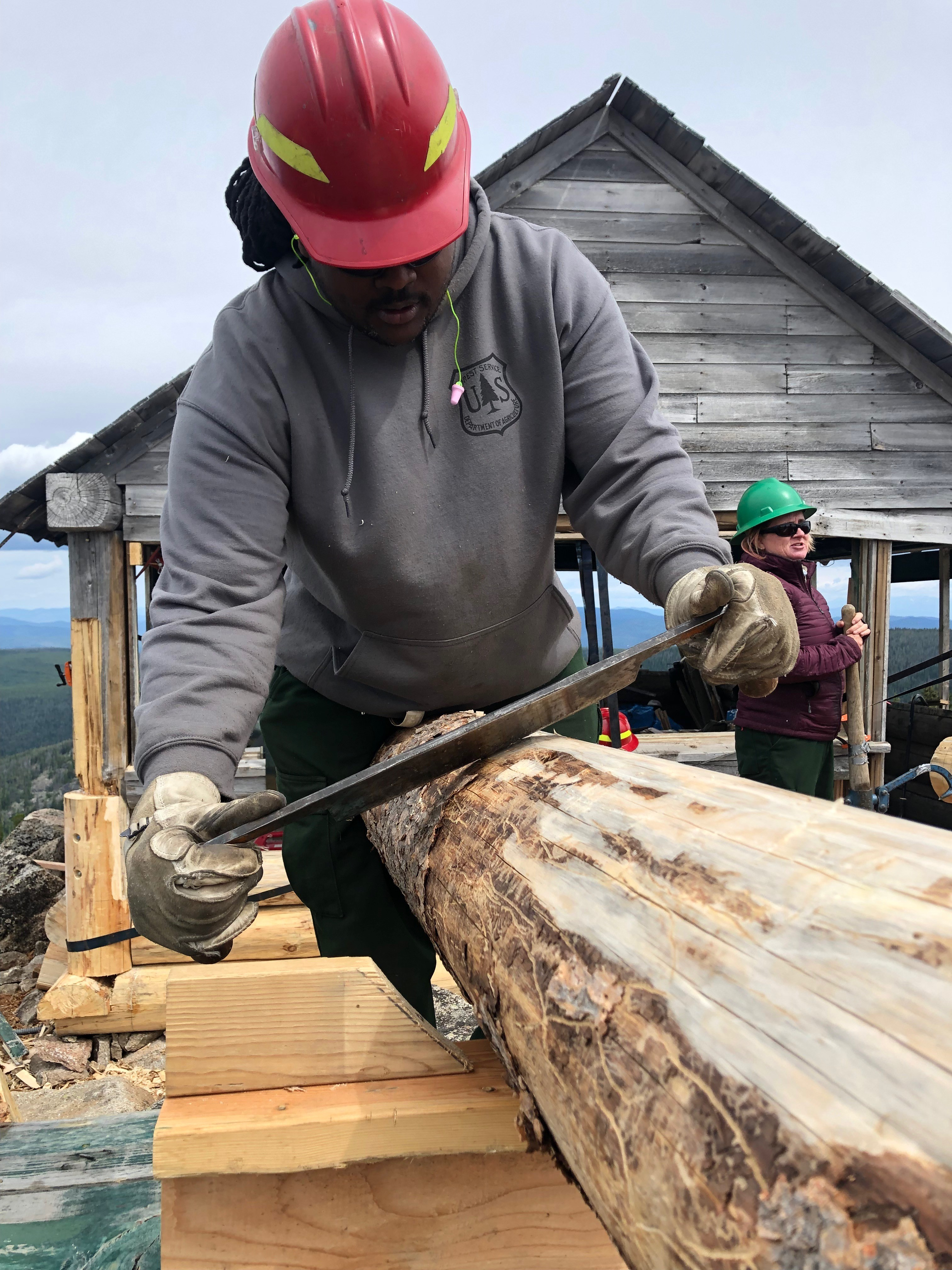 Forest Service employee at work rennovating an historic lookout