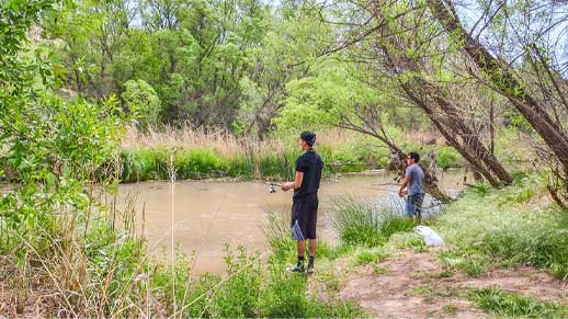 Two people fishing at Bignottie on the Verde River