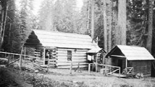 Historic black and white photo of a wood shelter