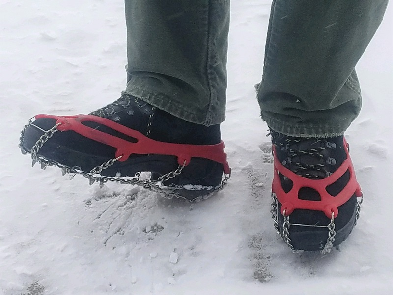 Shoes with traction devices attached in the snow