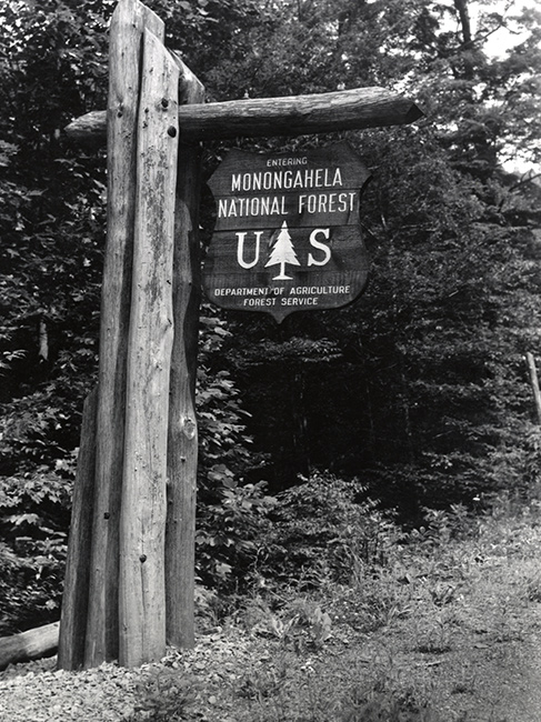 Early roadside entrance sign welcoming drivers to Monongahela National Forest, circa 1950. (USDA Forest Service photo)