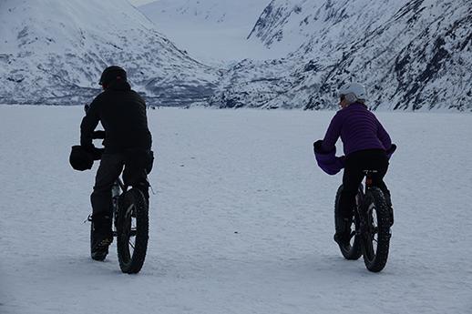 Winter bikers on Portage Lake.
