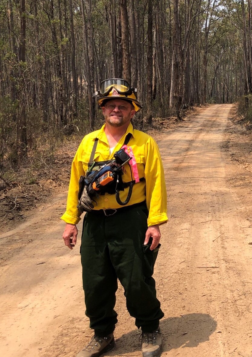 Firefighter on a dirt road in Australia