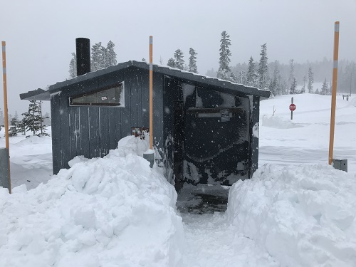 Restroom at Bennet Pass Sno Park with a shoveled path through the snow