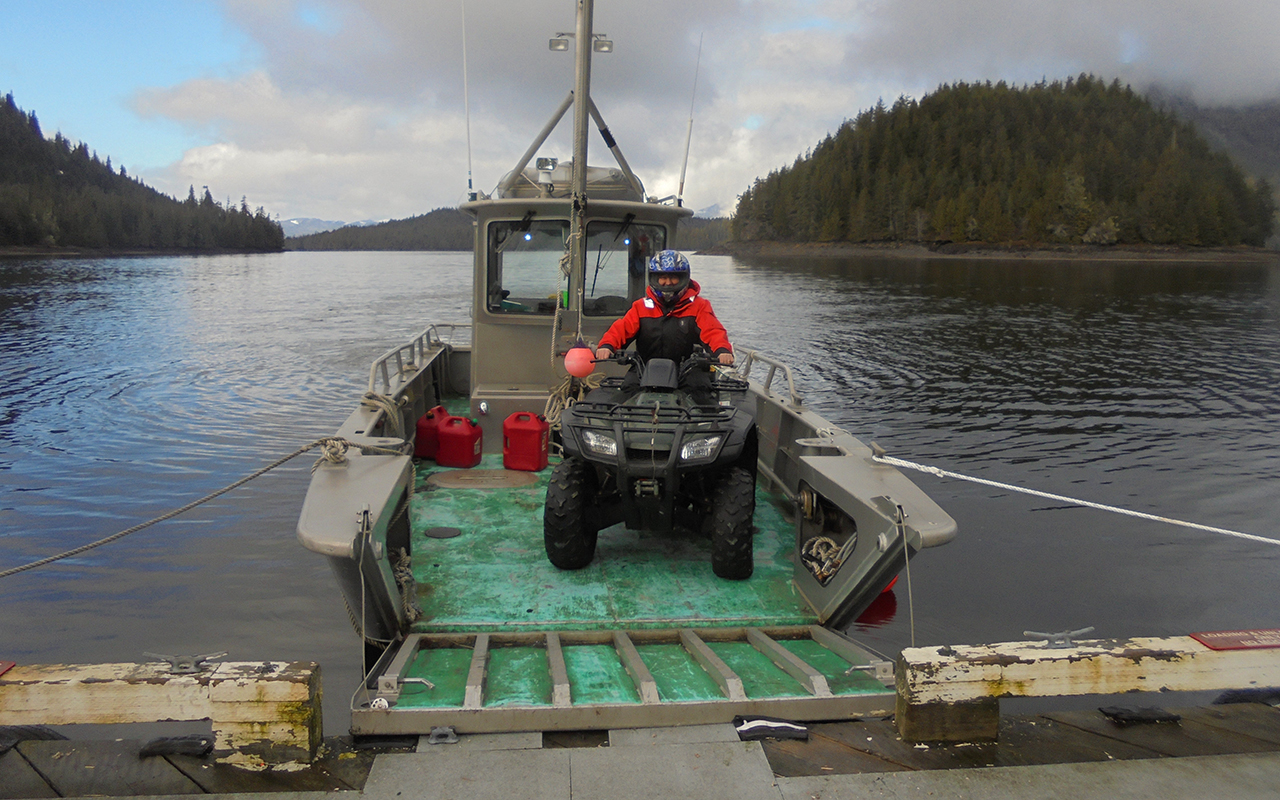 Art Williams offloads an ATV off the boat
