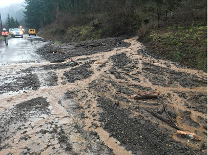 A mudslide covers the historic highway in the Gorge,