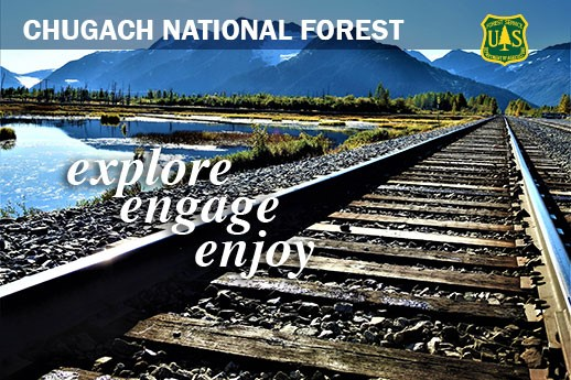 The Alaska Railroad tracks with words explore, engage, enjoy.