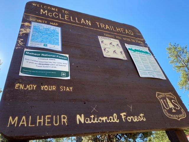 Image of the wooden sign indicating the McClellan Mountain Trailhead