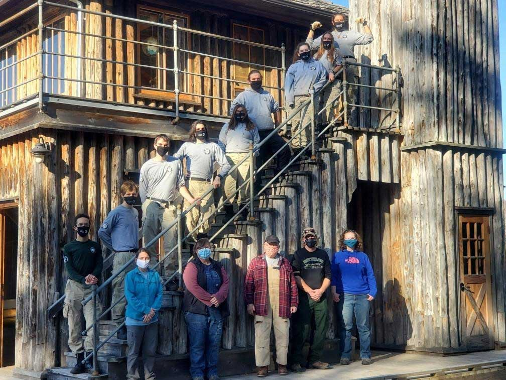 AmeriCorps members and Forest Service staff at the Forest Lodge boathouse.