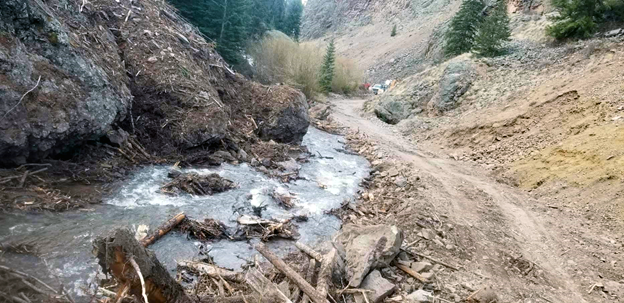 dirt road washed out by debris from avalanche, snowmelt & heavy rain