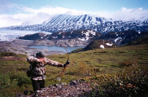 man bow hunting in the Kenai Mountains