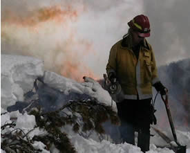 firefighter ignites pile in the snow