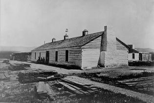 Black and white photograph of one of the long buildings at Fort Ruby