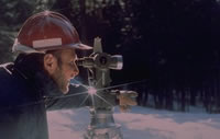 (photograph)  Surveyor working in winter.
