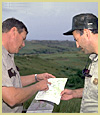 Two Forest Service Employees Reviewing Paper Work