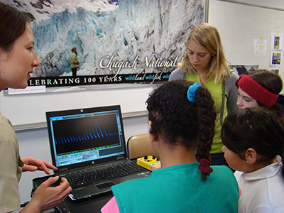 Wildlife Biologist Jessica Ilse leads the girl scouts in a bat echolocation exercise.