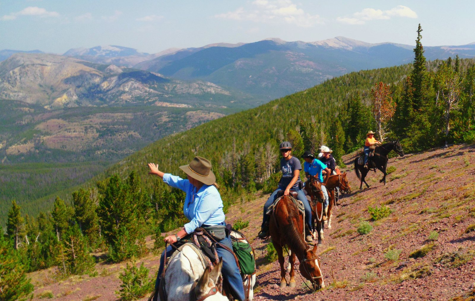 Back Country Horsemen and Montana youth travel on horseback to the top of Red Mountain