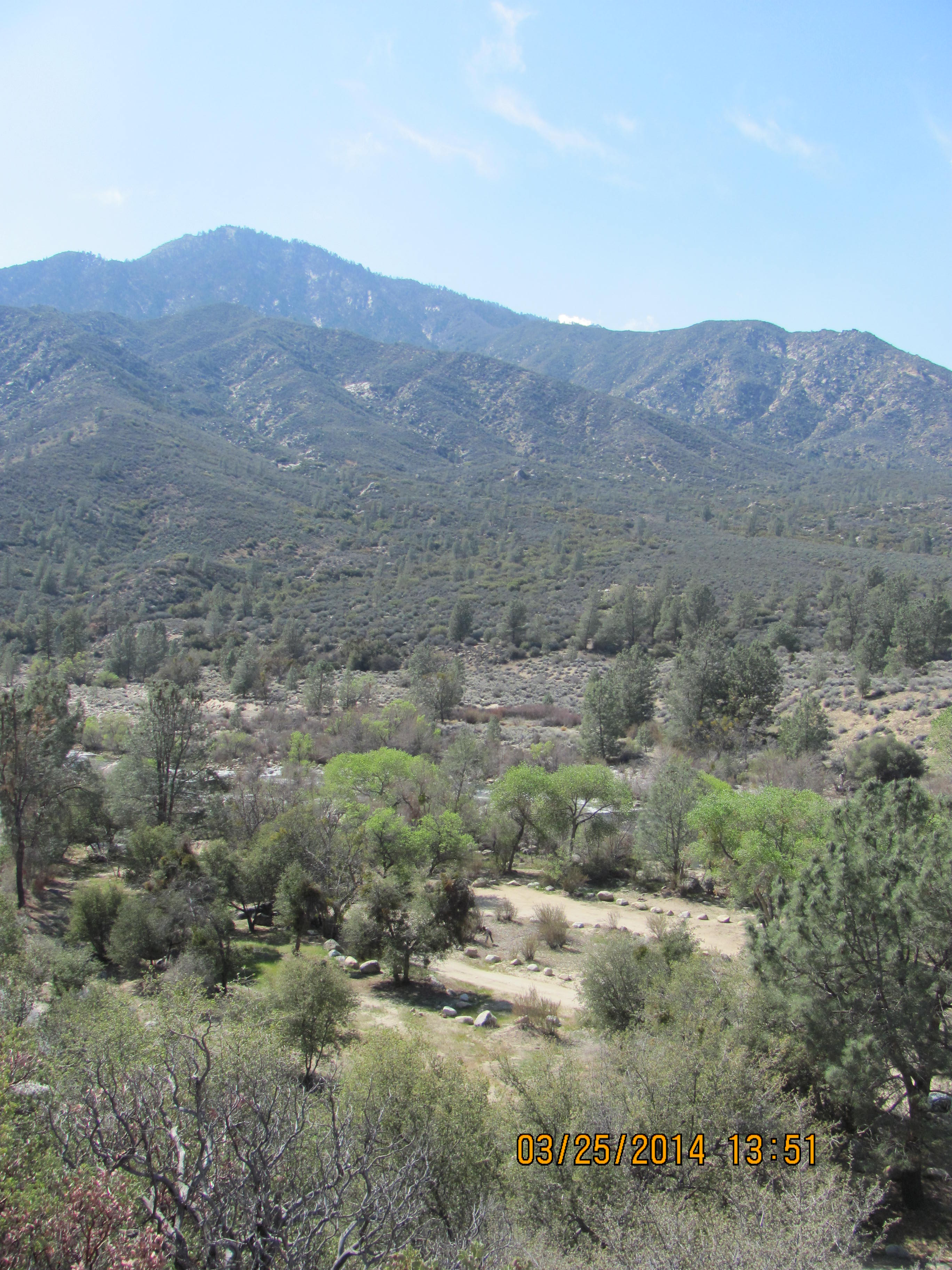 View looking down at Springhill from across M99, Kern River and mountains in background