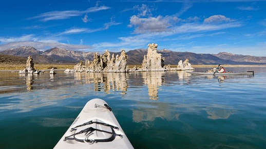 Kayak near tufa formation on Mono Lake, image by Julia Thomsen