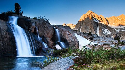 Waterfall and wildflowers evoke wilderness solitude