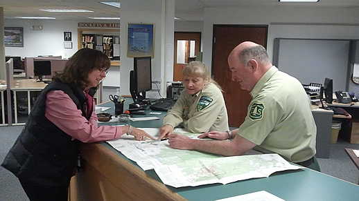 Public Lands Information Center Personnel Helping Customer