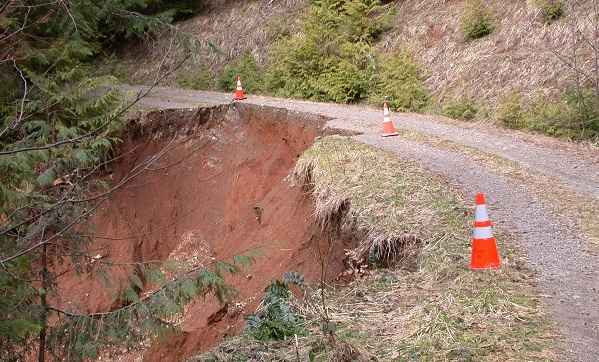A road damaged by a slide.