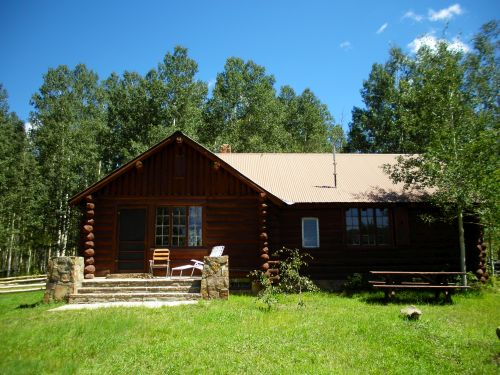 photo of cabin in  summer