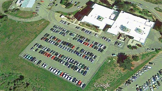 Aerial view of the FS Building, parking lot, and adjacent areas.