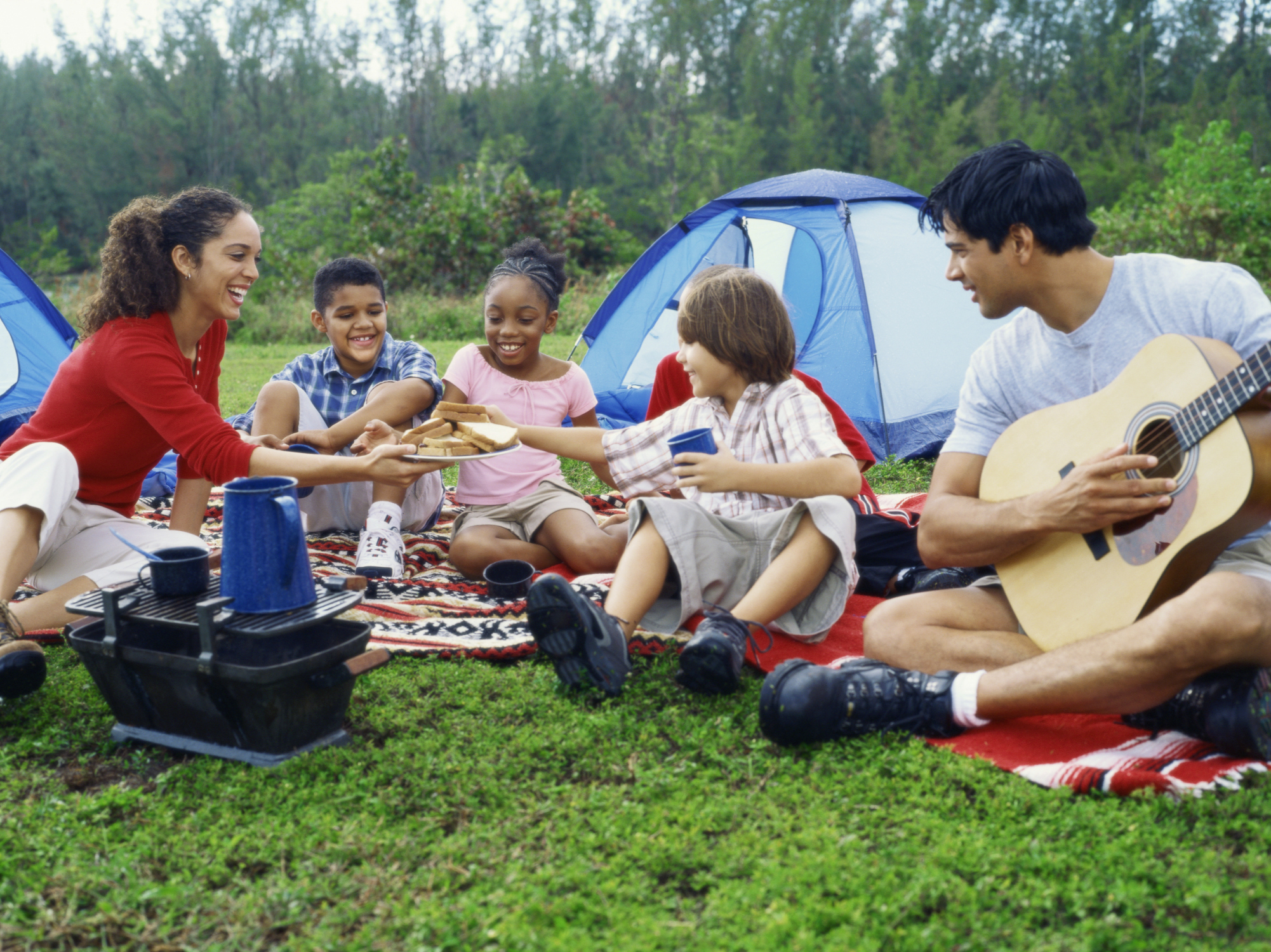 family with children tent camping
